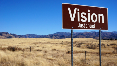 standpoint: Vision brown road sign with blue sky and wilderness
