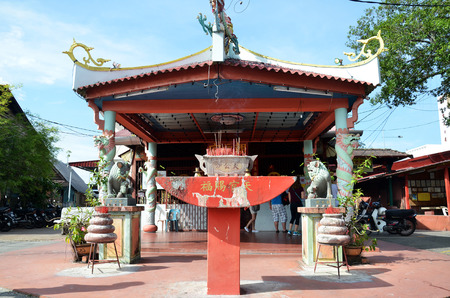 boatman: PENANG, MALAYSIA- 29 DECEMBER, 2016: Small temple at the entrance of the Chew Jetty, Penang, Malaysia. Chew Jetty is one of the old Chinese waterfront settlement in Penang.