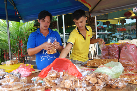 maltose: TUALANG, MALAYSIA-28 DECEMBER, 2016: Roadside stall selling maltose candy biscuit at Tualang in Malaysia. Tanjung Tualang in the Kinta Valley is synonymous with freshwater prawns