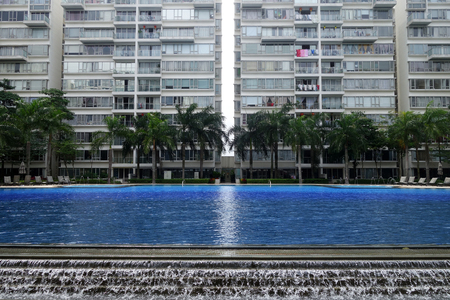 condo: SINGAPORE - JAN 25,2017: Typical Singapore high rise housing estate with big swimming pool.