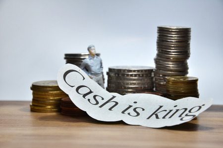 pay raise: Cash is King words with many coins
