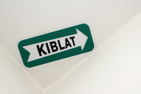 milepost: Kiblat Directional Sign in hotel room in Malaysia