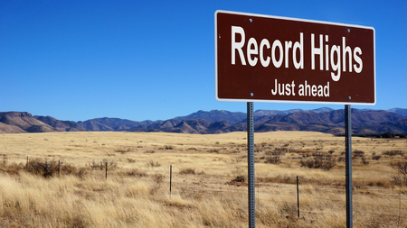 highs: Record Highs road sign with blue sky and wilderness Stock Photo
