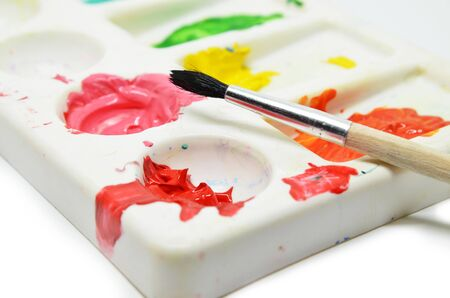 Watercolors with brush isolated on white background