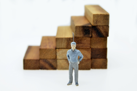 Way to success with mini businessman and wood block step Stock Photo