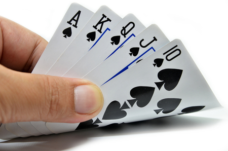Royal flush of spade on white background