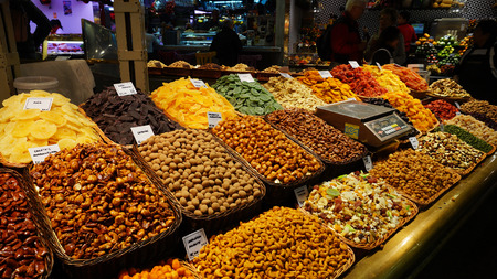 BARCELONA,SPAIN-FEB 18,2017: Various type of nuts in the famous La Boqueria market, next to Les Rambles in Barcelona, Catalonia, Spain Editorial