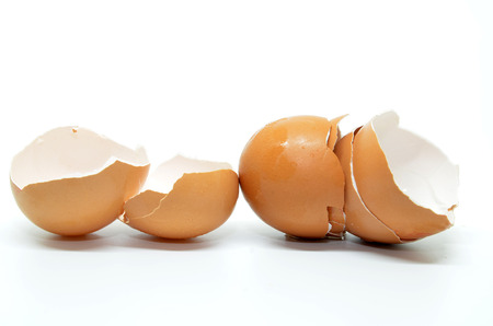 Broken egg shell isolated on white background