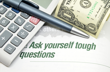 tough: Ask yourself tough questions printed on book Stock Photo