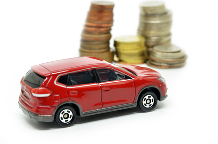 Car finance with money stack on white background