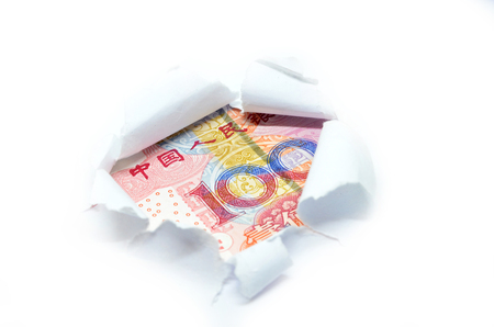 torn edge: China currency macro peeking through torn white paper Stock Photo
