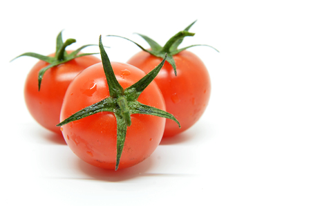 Red cherry tomato isolated on white background Stock Photo