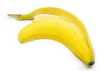 Slippery banana skin on a white background
