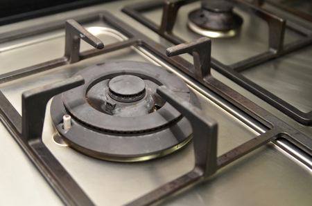 old gas stove: Fragment of a used gas kitchen stove