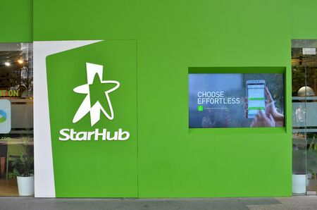 SINGAPORE- MAY 01, 2017: Sign of StarHub along the Orchard Road. StarHub Ltd is one of the three major telcos in Singapore.
