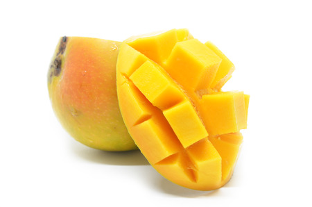 Mango cubes slices close up with mangos in white background Stock Photo