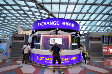 euromoney: BANGKOK, THAILAND- MAY 16, 2017: An exchange currency booth at the International Airport Suvarnabhumi which is the sixth busiest airport in Asia.