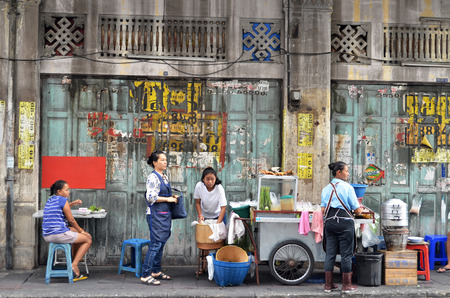 BANGKOK, THAILAND- MAY 19, 2017: Unidentified customers eats on a street in chinatown district, Bangkok, Thailand. Chinatown is renowned for its street food and outdoor dining.