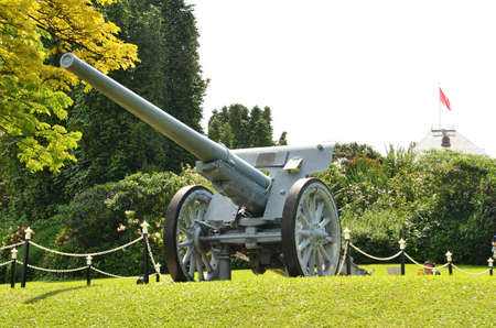 SINGAPORE- MAY 28, 2017: Cannon located on the green field in Istana, residency of Singapore President.