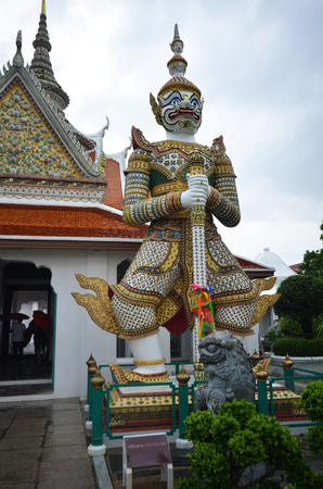 BANGKOK, THAILAND- MAY 19, 2017:  Giant statue, represented gate keeper, at entrance of Dawn temple or Wat Arun, the landmark of Bangkok, Thailand Editorial