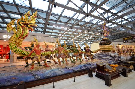 suvarnabhumi: BANGKOK, THAILAND- MAY 16, 2017: Traditional Thai dragon and dancers statue in the departues area of Suvarnabhumi Airport Bangkok Thailand Editorial