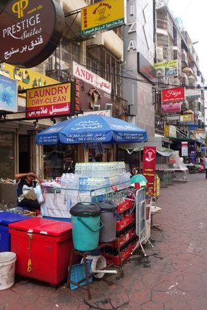 foreigner: BANGKOK, THAILAND- 21 MAY, 2016: Small street along Sukhumvit road in downtown of Bangkok, Thailand. Sukhumvit road is one of tourist hub in Bangkok Editorial