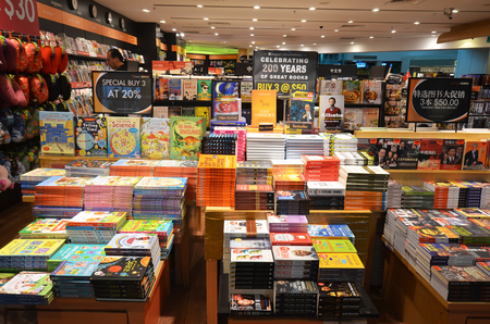 SINGAPORE- JUN 18, 2017: Customers shop for books in Changi Airport, Singapore. Singapore airport provides the best shopping experience to the passengers. Editöryel