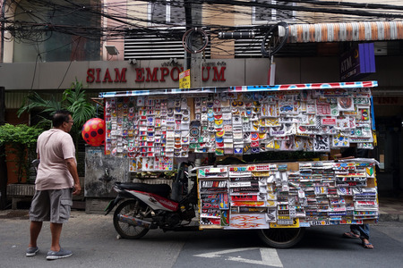 converted: BANGKOK, THAILAND- 21 MAY, 2016: Small mobile business selling stickers. The are hundreds of these types of small businesses being run from converted motorcycles in Thailand.