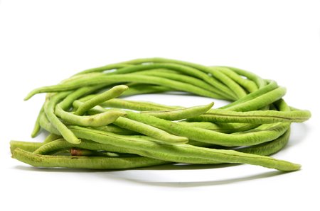 Long green beans isolated on white