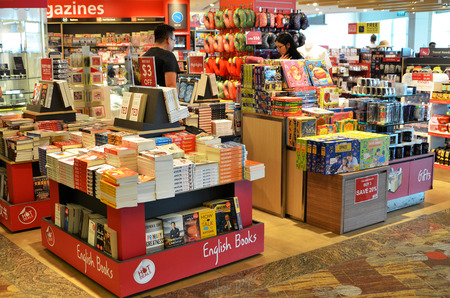 SINGAPORE- JUN 18, 2017: Customers shop for books in Changi Airport, Singapore. Singapore airport provides the best shopping experience to the passengers. Editorial