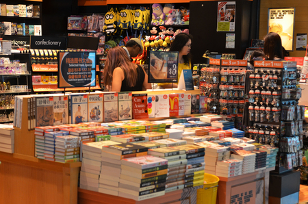 store shelf: SINGAPORE- JUN 18, 2017: Customers shop for books in Changi Airport, Singapore. Singapore airport provides the best shopping experience to the passengers. Editorial