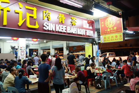 popular soup: KOTA KINABALU, MALAYSIA- 24 JUN 2017: Customers queeing at Sin Kee Bah Kut Teh at Kota Kinabalu, Sabah. Bak-kut-teh is a meat dish cooked in broth popularly served in Malaysia and Singapore