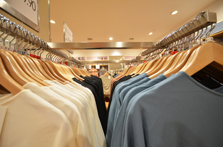industry trends: Designer clothes hanger in a row in a shop