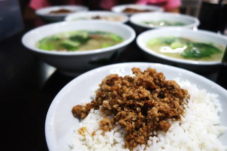 rou: Braised pork rice bowl - Ground pork marinated and boiled in soy sauce served on top of steamed rice