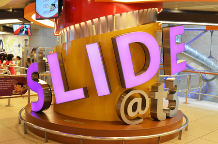 SINGAPORE- JUN 18, 2017: SlideT3 in Singapore Changi Airport is the worlds tallest airport slide, and a must for any kid.