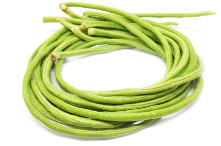 Bunch of fresh long bean isolated on white background Stock Photo