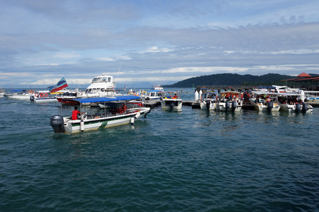 KOTA KINABALU, MALAYSIA- 24 JUN 2017: View of tourist boats at Jetty Jesselton Point, Kota Kinabalu, Sabah. This jetty provided tourists facilities to the islands in Tunku Abdul Rahman Marine Park nearby.