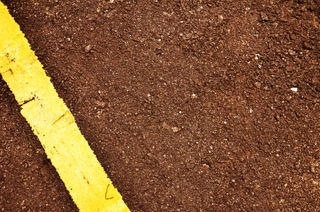 Black road pavement with single yellow line Stock Photo