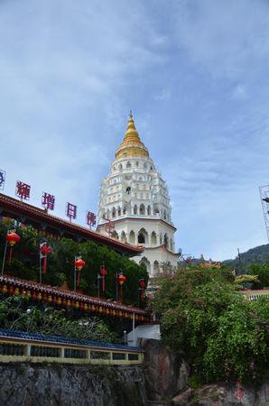 Buddhist temple Kek Lok Si in Penang, Malaysia. Chinese writting on the Buddha blessing on top of the building