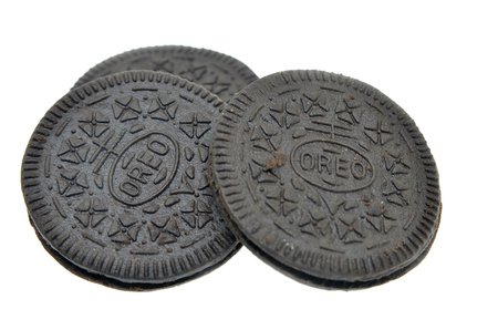 SINGAPORE - AUGUST 20, 2017: OREO cookie consisting of two chocolate wafers with a sweet creme filling in between (American cookie brand) on white background