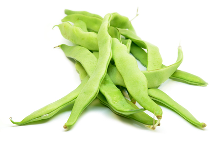 Fresh green hyacinth beans isolated on a white background.