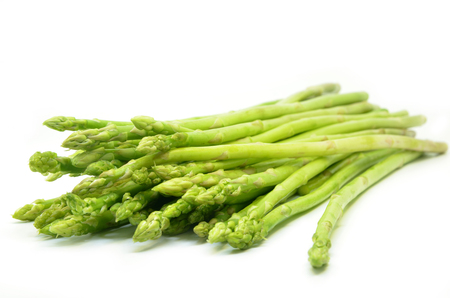 Bundle of green asparagus shoots isolated over white
