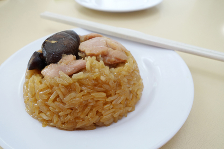 Steamed glutinous rice with chicken. Chinese Food Stock Photo