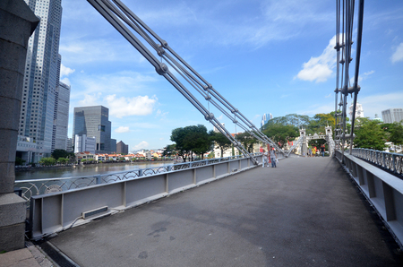 SINGAPORE - DECEMBER 02 2017: Historic Cavenagh Bridge spanning the Singapore River near Raffles Place.
