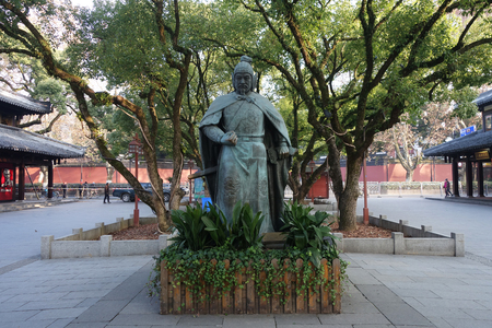HANGZHOU, CHINA-JAN 08, 2018: Statue of General Yue Fei located next to West Lake in Hangzhou, China. Yue Fei was a general of the Southern Song dynasty who fought against the Jurchen Jin Dynasty