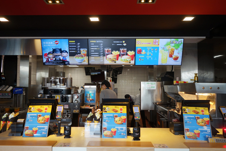 SHANGHAI, CHINA-JAN 08, 2018: Inside McDonalds restaurant located in Shanghai, China. McDonalds is an American hamburger and fast food restaurant chain.