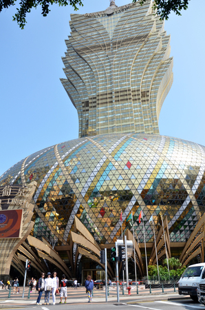 MACAU, CHINA- MAR 31, 2018: Grand Lisboa Hotel comprised of an ultramodern tower rising from a striking geodesic dome, this iconic casino hotel