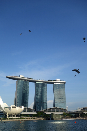 SINGAPORE-JUNE 17, 2018: Group of parachuters had just jumped out of a plane around Marina Bay Sands in the afternoon in Singapore