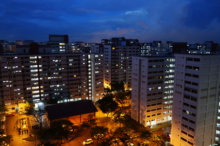 SINGAPORE-JUNE 27, 2018: Housing apartment building in Singapore City during twilight in the morning. Editorial
