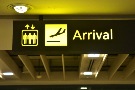 Airport arrival sign hanging from airport ceiling Archivio Fotografico
